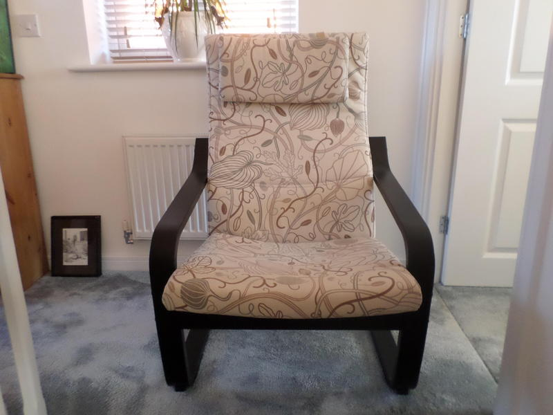 Ikea Poang Chairs black frame with leaf print covers in